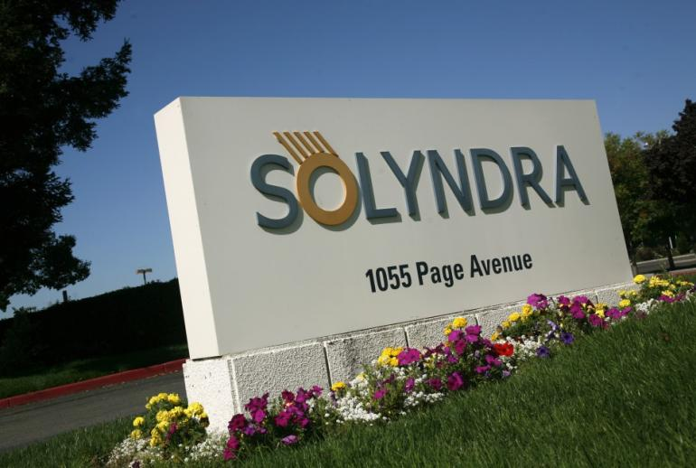 162284-a-sign-at-the-entrance-to-the-headquarters-of-bankrupt-solyndra-llc-is.jpg
