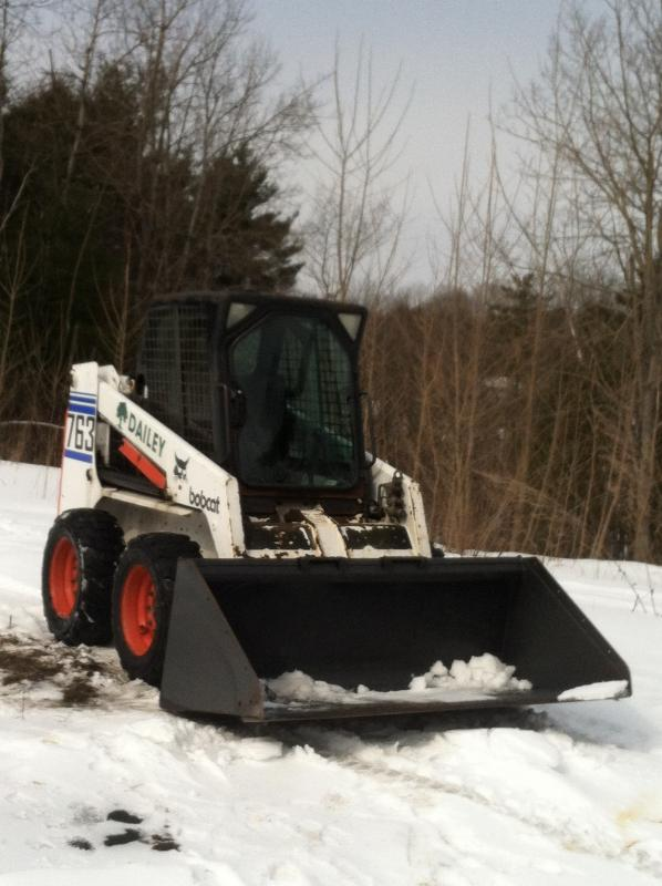 bobcat with snow bucket.jpg