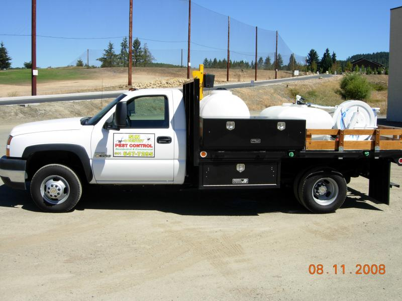 Chevy truck with spray Equip. and Auger Equip 001.jpg