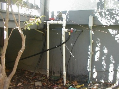 Copy of funny pvc plumbing coming out of home.jpg