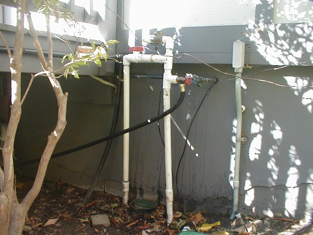 funny pvc plumbing coming out of home.jpg