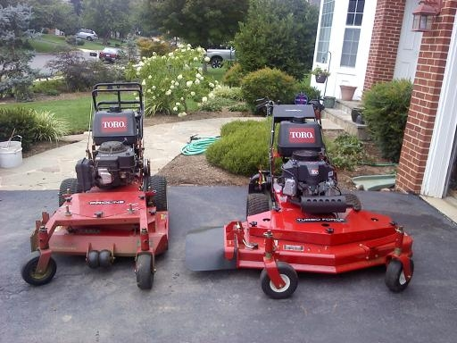 New mower next to old mower.JPG