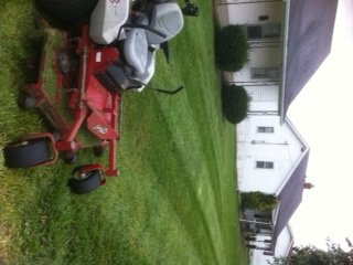 powell street front with mower.jpg