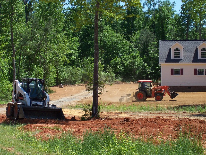 small bobcat and tractor.jpg