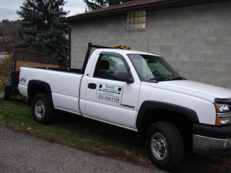 truck on side of garage with dump trailer.jpg