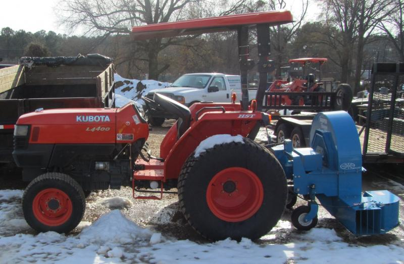 turf tractor with a blower.jpg